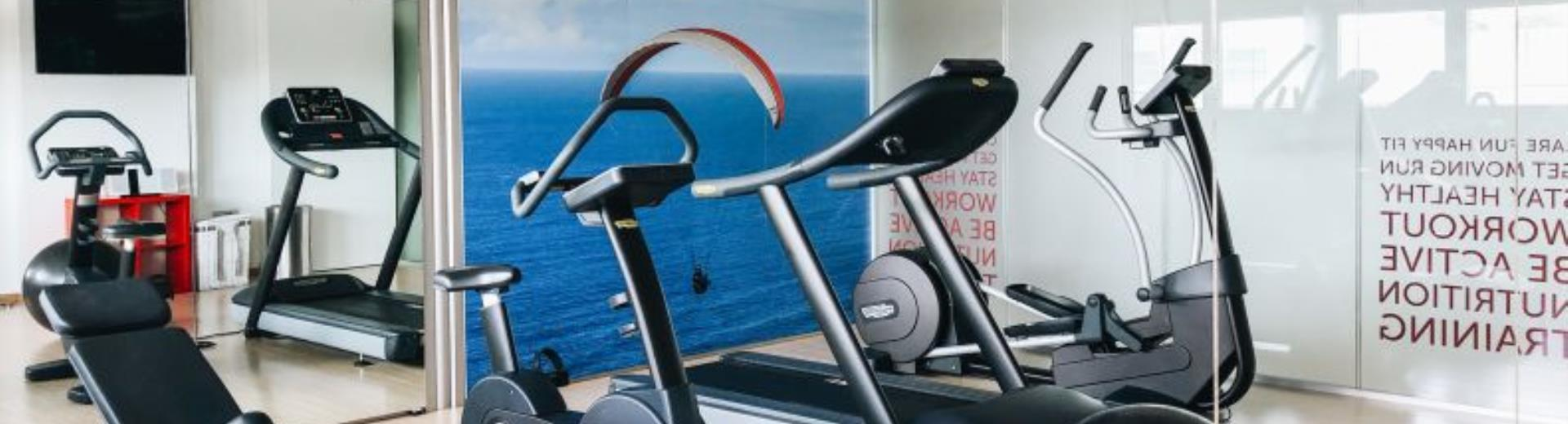 Modern fitness center fully equipped and available 24h
